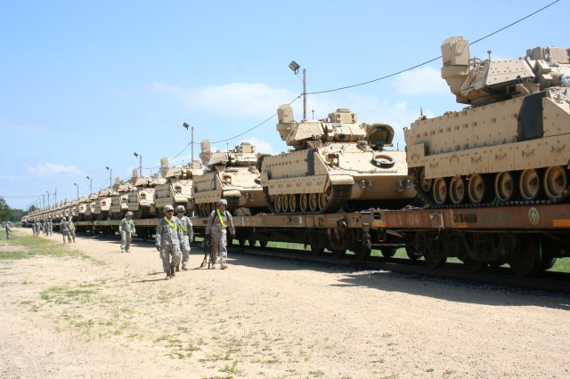 Soldiers from the 5th Squadron, 4th Cavalry Regiment (5th, 4th), 1st Infantry Division, prepare to unload Bradley Fighting Vehicles at the Fort McCoy rail yard July 22. The 5th, 4th is an active-duty unit from Fort Riley, Kan., and is serving as opposing forces for the Exportable Combat Training Capability exercise.