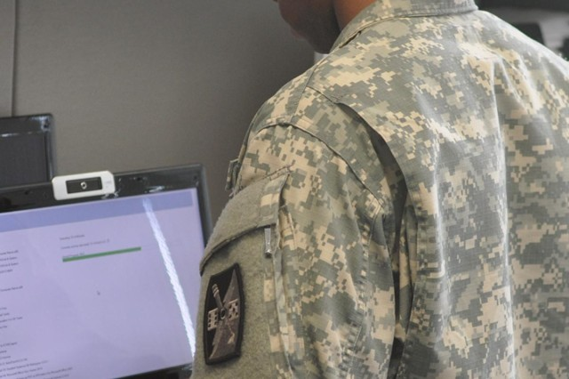 """A North Carolina National Guard Soldier updates computers at the Guard's Joint Force Headquarters in Raleigh, N.C., Aug. 4, 2014. The North Carolina National Guard is """"Always Ready"""" against any threat including cyber attacks.  Our Soldiers, Airmen and staff stand poised, ready and capable to support the National Guard Bureau`s intent to stand up multiple Cyber Protection Teams in support of U.S. Cyber Command."""