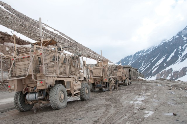In the Salang Pass of northeastern Afghanistan, Soldiers assigned to the 114th Transportation Company and 730th Transportation Company halt their May 10 convoy escort operation momentarily to refuel their vehicles, which included MRAPs. The vehicle has been a lifesaver in theater and was once one of DOD's highest-priority acquisition items. Almost 22,000 MRAPs came to the Army. Now, however, the Army plans to keep 8,585 of the most effective MRAP variants while divesting the remaining assets.