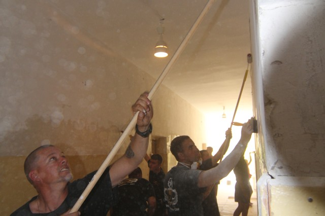 Paratroopers with Troop A, 1st Squadron, 91st Cavalry Regiment, 173rd Airborne Brigade, apply primer to the walls of an orphanage in Pabrade, Lithuania, July 26, 2014. 'Sky Soldiers' from Troop A volunteered their time to assist the orphanage in renovations while the children were on vacation in Poland. The 173rd Airborne is currently conducting combined training as part of Operation Atlantic Resolve at the request of host nations Lithuania, Estonia, Latvia, Poland and Romania to reinforce the United States' commitment to the security of its NATO partners.