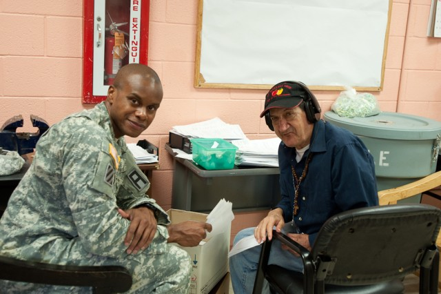 Capt. Barron Cole, 5th Armored Brigade information technology officer-in-charge, takes a break from workshop to pose with one of the residents from the El Paso State Supported Living Center during the Dagger Brigade's visit to the center, recently. (Photo by Capt. John A. Brimley, 5th Armored Brigade, Division West Public Affairs)