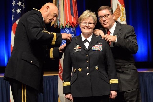 Lt. Gen. Karen Dyson gets her new rank affixed to her uniform by Chief of Staff of the Army Gen. Ray Odierno, and her husband, retired Air Force Col. James Chamberlain, at the Pentagon, Aug. 12, 2014. Dyson joins the ranks of the other female three-star generals currently serving in the Army: Judge Advocate General Lt. Gen. Flora Darpino; Army Surgeon General Lt. Gen. Patricia Horoho; Army Deputy Chief of Staff for Intelligence Lt. Gen. Mary Legere; and Deputy Commanding General of Army Materiel Command Lt. Gen. Patricia McQuistion.