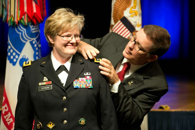 Lt. Gen. Karen Dyson smiles as her husband, Retired Air Force Col. James Chamberlain, puts the finishing touches on her uniform, as he affixes her new rank at the Pentagon, Aug. 13, 2014. Dyson joins the ranks of the other female three-star generals currently serving in the Army: Judge Advocate General Lt. Gen. Flora Darpino; Army Surgeon General Lt. Gen. Patricia Horoho; Army Deputy Chief of Staff for Intelligence Lt. Gen. Mary Legere; and Deputy Commanding General of Army Materiel Command Lt. Gen. Patricia McQuistion.