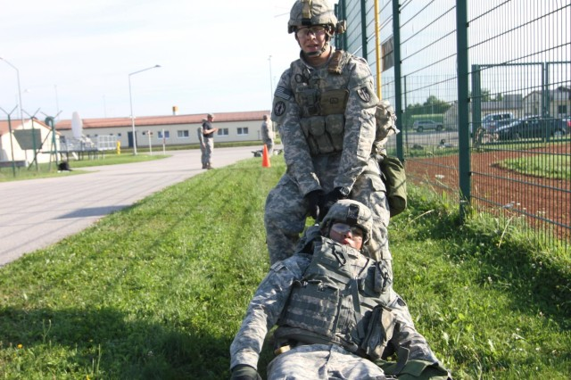 Sgt. Donald Heavener, a native of Kansas City, Mo., drags Pfc. Ariel Galvan, a notional casualty and a native of Santa Ana, Calif. during the 527th Military Police Company's Mogadishu Mile July 23 in Hohenfels, Germany. (Photo by Staff Sgt. Christina J. Turnipseed, 18th MP Public Affairs)