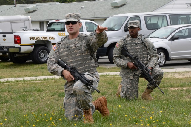 """Spc. Michael Lemus (left) calls out directions to his squad during land navigation training at Fort A.P. Hill, Virginia, April 28. Lemus is a cryptologic linguist with Company D, 715th Military Intelligence Battalion, 500th Military Intelligence Brigade, Schofield Barracks, Hawaii, and the U.S. Army Intelligence and Security Command's and U.S. Army Military District of Washington's """"Best Soldier.""""  (U.S. Army photo by Sgt. Jesus J. Aranda Jr., U.S. Army Intelligence and Security Command Public Affairs)"""