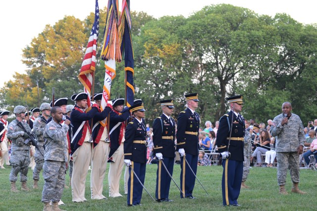 "Soldiers from the 3rd U.S. Infantry Regiment (The Old Guard) and the U.S. Army Band ""Pershing's Own"" perform during U.S. Army Military District of Washington's Twilight Tattoo on Whipple Field, Joint Base Myer-Henderson Hall, Va., Aug. 13, 2014."