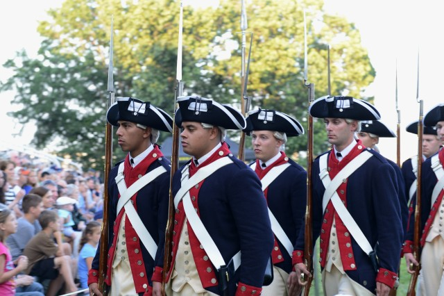 Soldiers from the 3rd U.S. Infantry Regiment (The Old Guard) perform during U.S. Army Military District of Washington's Twilight Tattoo on Whipple Field, Joint Base Myer-Henderson Hall, Va., Aug. 13, 2014.