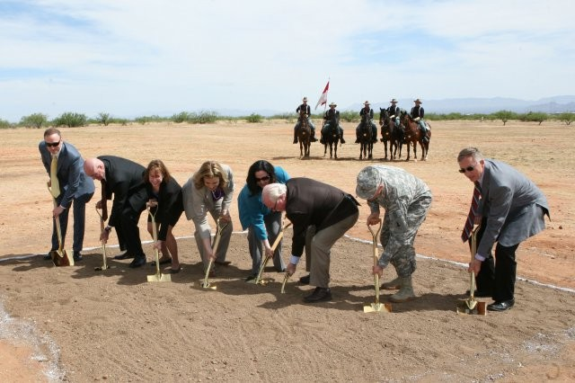 In this photo from April 2014, Katherine Hammack, assistant secretary of the Army for Installations, Energy and Environment (in blue jacket), takes part in the groundbreaking at Fort Huachuca, Ariz., for a solar array park.