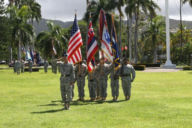 FORT SHAFTER, Hawaii - Major Gen. James Pasquarette, U.S. Army Pacific Chief of Staff, commands a Flying V formation honoring Maj. Gen. Roger Mathews, USARPAC deputy commanding general, as a celebration of Mathews' 36 years of service on the occasion of his retirement. (Photo by Staff Sgt. Kyle Richardson, USARPAC Public Affairs)