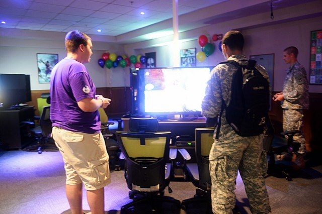 During the first two months, the new Humphreys Gaming, located in the Community Activity Center, has averaged about 150 users a day. The main game room features a plethora of high-tech gaming options for Soldiers and families, including an X-Box Kinect and 16 47-inch LG Smart televisions, each hooked up to X-Box 360's and PS3's. The computers and video games are all free to play and the arcade games are token-operated and charge a nominal fee. -- U.S. Army photo by Terese Toennies
