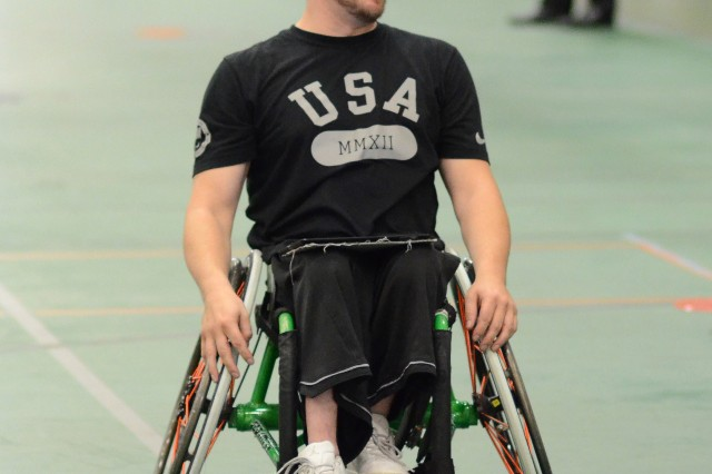 Jason Nelms, 2004 London Games Paralympian and University of Texas at Arlington coach, keeps an eye on the action during a National Wheelchair Basketball Association sponsored training camp, Aug. 7 at Specker Field House.