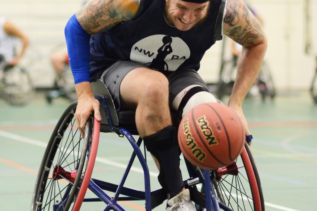 Adam Hygema from Atlanta, Georgia, charges down the court during a National Wheelchair Basketball Association sponsored training camp, Aug. 7 at Specker Field House.