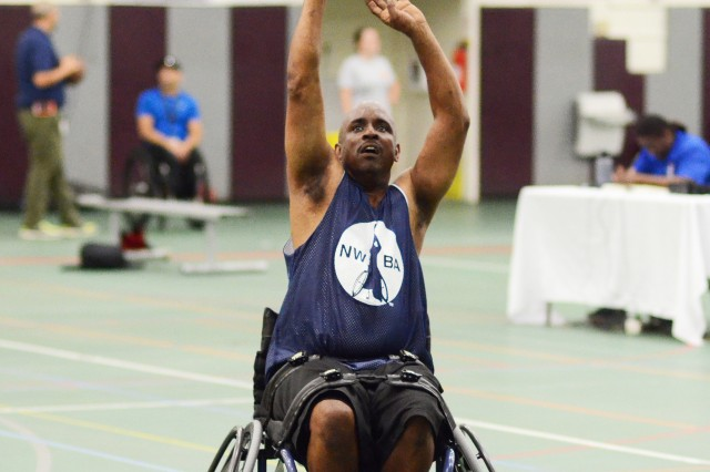Robert James of Atlanta, Georgia, shoots from near the free-throw line during a National Wheelchair Basketball Association sponsored training camp, Aug.7 at Specker Field House.