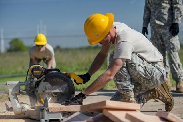 Staff Sgt. Stephen Orodi, a carpenter with the 486th Engineer Company from Columbus, Ohio, cuts a 2x12 board for a wooden hut at the Joliet Training Area in Elwood, Ill., to prepare the site for a Warrior Training Exercise scheduled for May 2015. The company used this work as an innovative readiness training opportunity to maintain and improve its engineer skills. The Joliet Training Area is the largest local training area run by the 88th Readiness Support Center in the Army Reserve. The 486th Eng. Company falls under the 416th Theater Engineer Command. (U.S. Army photo by Sgt. 1st Class Michel Sauret)