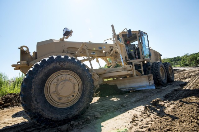 Sgt. Brian Guzman, with the 317th Engineer Company from Delavan, Wis., uses a motor grader to clear a dirt path at the Joliet Training Area in Elwood, Illinois, to prepare the site for a Warrior Training Exercise scheduled for May 2015. The company used this work as an innovative readiness training opportunity to maintain and improve its engineer skills. The Joliet Training Area is the largest local training area run by the 88th Readiness Support Center in the Army Reserve. The 317th Eng. Company falls under the 416th Theater Engineer Command. (U.S. Army photo by Sgt. 1st Class Michel Sauret)