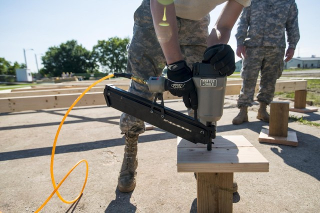 An engineer from the 486th Engineer Company nails down a support stump for a wooden hut at the Joliet Training Area in Elwood, Ill., to prepare the site for a Warrior Training Exercise scheduled for May 2015. The company used this work as an innovative readiness training opportunity to maintain and improve its engineer skills. The Joliet Training Area is the largest local training area run by the 88th Readiness Support Center in the Army Reserve. The 486th Eng. Company falls under the 416th Theater Engineer Command. (U.S. Army photo by Sgt. 1st Class Michel Sauret)