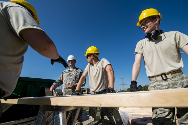 Engineers from the 486th Engineer Company prepare beams for a wooden hut at the Joliet Training Area in Elwood, Ill., to prepare the site for a Warrior Training Exercise scheduled for May 2015. The company used this work as an innovative readiness training opportunity to maintain and improve its engineer skills. The Joliet Training Area is the largest local training area run by the 88th Readiness Support Center in the Army Reserve. The 486th Eng. Company falls under the 416th Theater Engineer Command. (U.S. Army photo by Sgt. 1st Class Michel Sauret)