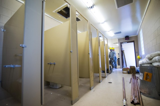 Engineers from the 486th Engineer Company work to replace toilets, urinals and plumbing for a latrine at the Joliet Training Area in Elwood, Ill., to prepare the site for a Warrior Training Exercise scheduled for May 2015. The company used this work as an innovative readiness training opportunity to maintain and improve its engineer skills. The Joliet Training Area is the largest local training area run by the 88th Readiness Support Center in the Army Reserve. The 486th Eng. Company falls under the 416th Theater Engineer Command. (U.S. Army photo by Sgt. 1st Class Michel Sauret)