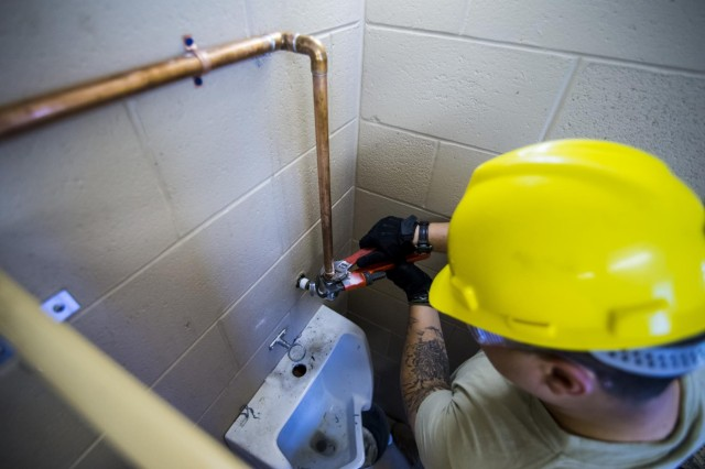 Sgt. Alexander Judson, of Auburn Hills, Mich., with the 486th Engineer Company, works to replace a urinal at the Joliet Training Area in Elwood, Illinois, to prepare the site for a Warrior Training Exercise scheduled for May 2015. The company used this work as an innovative readiness training opportunity to maintain and improve its engineer skills. The Joliet Training Area is the largest local training area run by the 88th Readiness Support Center in the Army Reserve. The 486th Eng. Co. falls under the 416th Theater Engineer Command. (U.S. Army photo by Sgt. 1st Class Michel Sauret)