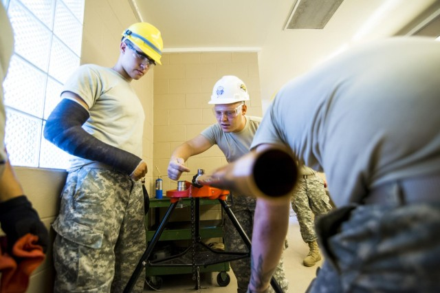 Engineers from the 486th Engineer Company work to replace the plumbing of a latrine at the Joliet Training Area in Elwood, Illinois, to prepare the site for a Warrior Training Exercise scheduled for May 2015. The company used this work as an innovative readiness training opportunity to maintain and improve its engineer skills. The Joliet Training Area is the largest local training area run by the 88th Readiness Support Center in the Army Reserve. The 486th Eng. Co. falls under the 416th Theater Engineer Command. (U.S. Army photo by Sgt. 1st Class Michel Sauret)