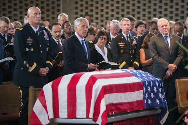 """Army Chief of Staff Gen. Ray Odierno, Secretary of Defense Chuck Hagel and Assistant Secretary of the Army for Acquisition, Logistics and Technology Heidi Shyu join in singing the congregational hymn, """"Onward Christian Soldier"""" during the funeral service of Maj. Gen. Harold J. Greene at Joint Base Myer-Henderson Hall Memorial Chapel in Arlington, Va., Aug. 14, 2014. Greene is the highest-ranking service member killed in the Iraq and Afghanistan wars."""