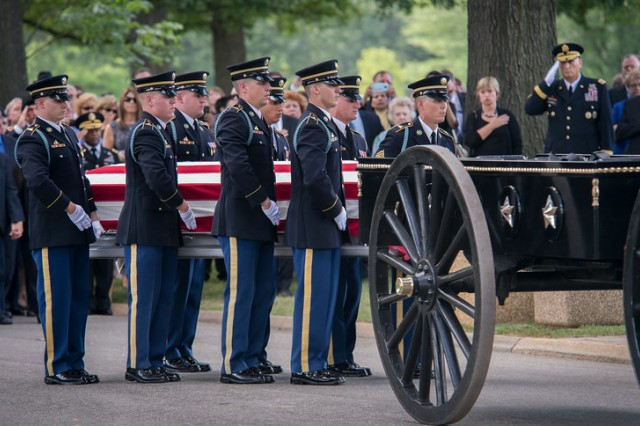 Eight Soldiers from the Old Guard Caisson Platoon serve as pall bearers to carry the casket of Maj. Gen. Harold J. Greene from the caisson to his final resting place in section 60 at Arlington National Cemetery, Aug. 14, 2014. Greene is the highest-ranking U.S. military officer to be killed in combat since Vietnam.