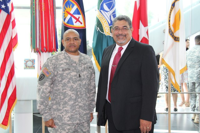 Command Sgt. Maj. Robert Austin, new U.S. Army Evaluation Center command sergeant major, with AEC Director David Jimenez at an assumption of responsibility ceremony Aug. 14 at AEC headquarters.