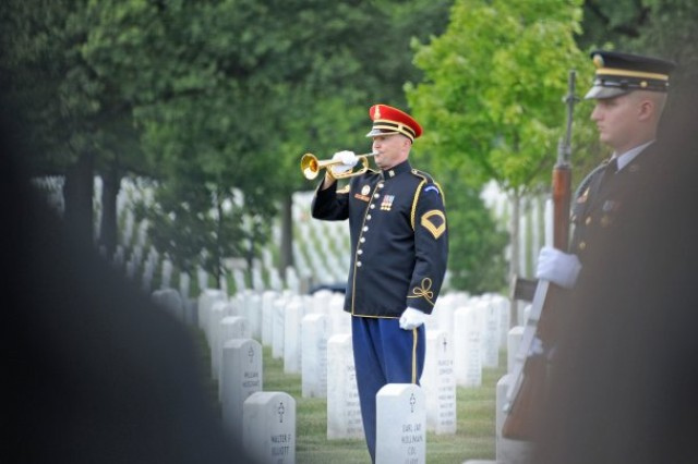 The Old Guard bugler plays Taps at the funeral of Maj. Gen. Harold J. Greene, Aug. 14, 2014, at Arlington National Cemetery. Greene was the highest-ranking military officer to be killed in the Iraq and Afghanistan wars.