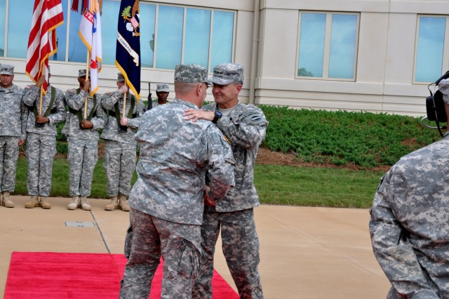 Gen. Mark A. Milley, left, commanding general, U.S. Army Forces Command, shakes hands with former Gen. Daniel B. Allyn, outgoing FORSCOM commander and new Army vice chief of staff, during an Aug. 15, 2014, change-of-command ceremony at Fort Bragg, N.C.
