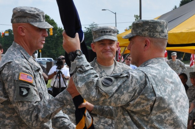 Gen. Mark A. Milley passes the colors of U.S. Army Forces Command to Command Sgt. Maj. Scott C. Schroeder, the FORSCOM senior enlisted adviser.  Gen. Daniel B. Allyn (center) had just relinquished command of FORSCOM to Milley in a ceremony at Fort Bragg, N.C., Aug. 15, 2014, officiated by Chief of Staff of the Army Gen. Raymond T. Odierno.  Milley becomes the 21st commanding general of FORSCOM.  Schroeder is ultimately responsible for the care and maintenance of the command's colors.