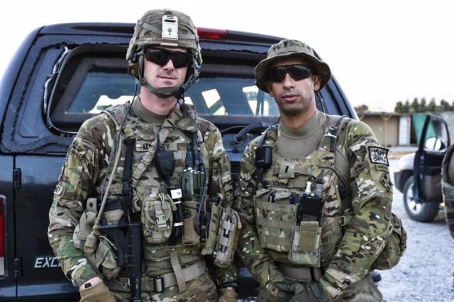 Sgt. Andrew Mahoney (left) of Laingsburg, Mich., with his platoon leader, 1st Lt. Florent Groberg, both of whom served on a personal security detail with the 4th Infantry Brigade Combat Team, 4th Infantry Division, during Mahoney's previous deployment in Regional Command-East, Afghanistan.