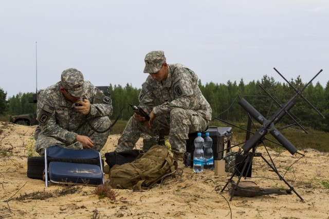 Staff Sgt. Robert Heaton (left), Jacksonville, Ark., and Spc. Bradley Slate, a native of Las Vegas, monitor and report weather conditions at the drop zone, during an airborne operation conducted by paratroopers from the 1st Squadron, 91st Cavalry Regiment, 173rd Airborne Brigade, in Adazi, Latvia, Aug. 7, 2014. The paratroopers in Latvia are demonstrating commitment to NATO obligations and increasing interoperability with allied forces as part of Operation Atlantic Resolve.