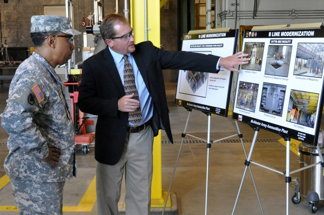 Brian Foris, project manager for B-Line modernization at McAlester Army Ammunition Plant, Okla., talks to Gen. Dennis L. Via, commanding general, U.S. Army Materiel Command, about the modernization effort. The project, partially funded by the U.S. Air Force, will improve MCAAP's production capabilities by providing flexibility and increasing efficiency and effectiveness of current operations. The  project took 18 months to complete, and is expected to be online by the end of the month.