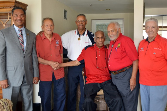 Retired Col. R.J. Lewis, far left, stands with members of the Tuskegee Airmen.