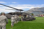 Soldiers from the 759th Military Police Battalion get ready to be transported to Butts Army Airfield from Pershing Field, on a UH-60 Black Hawk (MedEvac) from the 4th Combat Aviation Brigade, 4th Infantry Division, during 759th's MP competition on Fort Carson, Colo., Aug. 7, 2014.