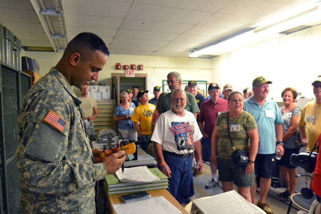 FORT CARSON, Colo. -- Sgt. Sharanbir Mander, avionics mechanic, Company D, 2nd General Support Aviation Battalion, 4th Aviation Regiment, 4th Combat Aviation Brigade, 4th Infantry Division, gives a tour of the CAB's avionics shop to Aviation Electrical Vietnam Veterans during their visit to 4th CAB hangars at Butts Army Airfield on Fort Carson, Colo., Aug. 7, 2014.    (Photo by Sgt. Jonathan C. Thibault, 4th Combat Aviation Brigade Public Affairs Office, 4th Infantry Division/Released)