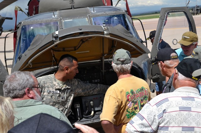 FORT CARSON, Colo. -- Sgt. Arturo Munguia, avionics squad leader, Company D, 3rd Assault Helicopter Battalion, 4th Aviation Regiment, 4th Combat Aviation Brigade, 4th Infantry Division, gives a tour of the electrical components of a UH-60 Blackhawk to Aviation Electrical Vietnam Veterans during their visit to 4th CAB hangars at Butts Army Airfield on Fort Carson, Colo., Aug. 7, 2014.    (Photo by Sgt. Jonathan C. Thibault, 4th Combat Aviation Brigade Public Affairs Office, 4th Infantry Division/Released)