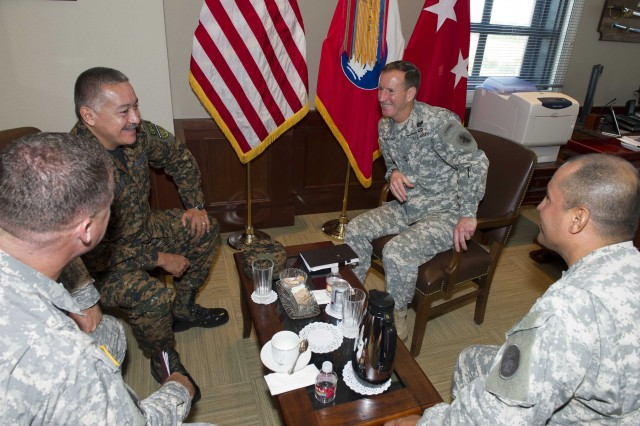 Salvadoran Brig. Gen. Armando Mejia (left) shares a laugh with Maj. Gen. Joseph P. Disalvo (right) during the U.S. Army South/Salvadoran army-to-army staff talks July 15 at the Army South headquarters on Fort Sam Houston, Texas.