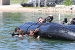 4th Maneuver Enhancement Brigade troops dive into water operations training