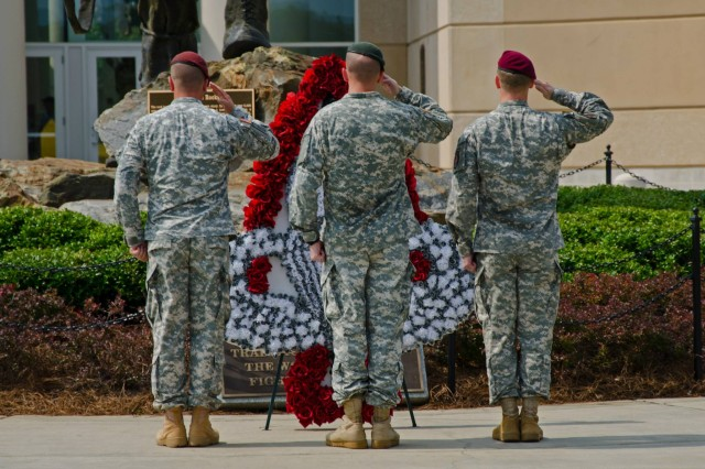 """Soldiers representing the Airborne and Special Forces community place a wreath at the """"Iron Mike"""" in honor of past and present Airborne Soldiers, in front of the Airborne & Special Operations Museum in downtown Fayetteville, N.C."""
