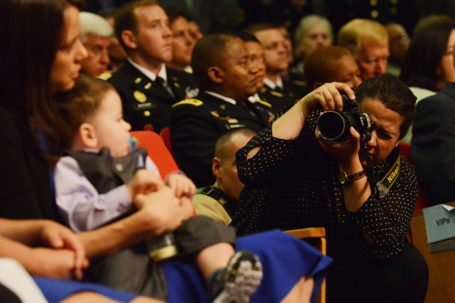 Lillian Boyd, a college intern for the Army News Service, photographs Medal of Honor recipient and former Staff Sgt. Ryan Pitts, during a July 22, 2014, Pentagon Hall of Heroes ceremony.
