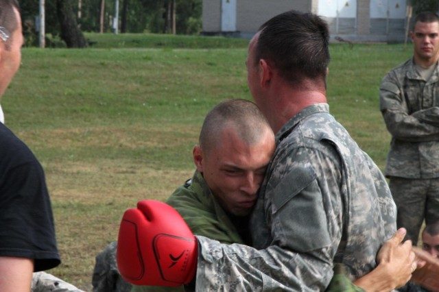 "A Lithuanian Land Forces ""Iron Wolf Brigade"" Soldier attempts to achieve ""the clinch"" on Combatives Level III instructor, Sgt. 1st Class Brett Macy of Indianapolis, a mortar platoon sergeant with 1st Squadron, 91st Cavalry Regiment, 173rd Airborne Brigade, during Combatives Level I certification Aug. 8. ""Sky Soldiers"" and ""Iron Wolves"" conducted combined training on Army Combatives Level I certification Aug. 4-8.The The 173rd Airborne is currently deployed to Estonia, Latvia, Lithuania and Poland in support of Operation Atlantic Resolve, combined exercises designed to demonstrate commitment to NATO obligations and sustain interoperability with allied nations. (Photo by Staff Sgt. Scott Griffin, 207th Public Affairs Detachment)"