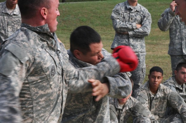 "Sgt. Albert Leija of Wichita Falls, Texas, a supply sergeant with Troop A, 1st Squadron, 91st Cavalry Regiment, 173rd Airborne Brigade, receives a blow to the face from Combatives Level III instructor Sgt. 1st Class Brett Macy of Indianapolis, a mortar platoon sergeant with 1st Sqdn., 91st Cav. Regt., during Combatives Level I certification Aug. 8. ""Sky Soldiers"" and Lithuanian Land Forces ""Iron Wolf Brigade"" Soldiers conducted combined training on Army Combatives Level I certification Aug. 4-8. The 173rd Airborne is currently deployed to Estonia, Latvia, Lithuania and Poland to demonstrate its commitment to NATO obligations and sustain interoperability with allied nations. (Photo by Staff Sgt. Scott Griffin, 207th Public Affairs Detachment)"