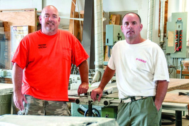 After completing a routine service call at an outlying Fort Drum range recently, Paul Gleason, left, and Mike Hewitt, carpenters assigned to Fort Drum Public Works' Buildings and Grounds Branch, helped put out a house fire in Antwerp while ensuring the safety of two pets stuck inside. Their shop supervisor has nominated each one for a Spirit of the Garrison Award.