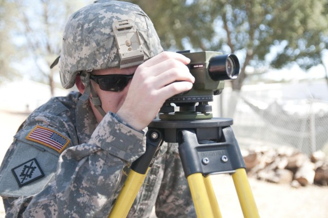 U.S. Army Reserve Sgt. Matt Morris, a technical engineer with the 476th Engineer Detachment, survey and design, from Quakertown, Pa., adjusts the automatic level to calculate the elevation for a project at Fort Hunter Liggett, Calif., at Castle Installation Related Construction, Aug. 6 to 19. (U.S. Army photo by Staff Sgt. Debralee Best)