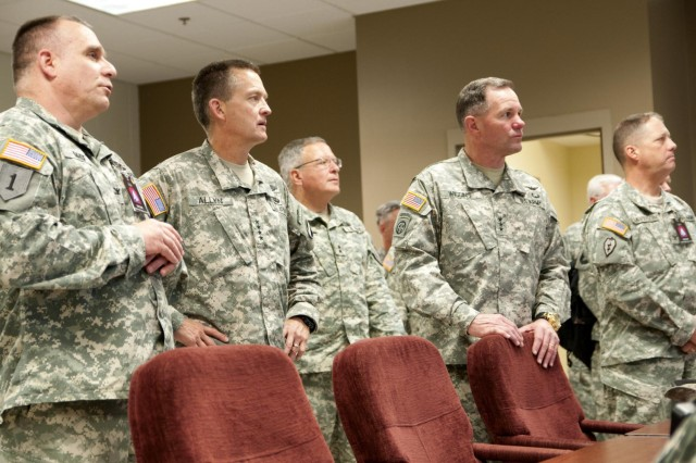 Members of the exercise command cell at Vibrant Response '14 brief Commanding General, U.S. Army Forces Command Gen. Daniel B. Allyn (second from left) about the exercise here July 22, 2014. Vibrant Response is a major field training exercise conducted by U.S. Northern Command and led by U.S. Army North. About 5,500 service members and civilians from the military and other federal and state agencies throughout the country are training to respond to a catastrophic domestic incident. (U.S. Army Photo by Spc. Anthony T. Zane)