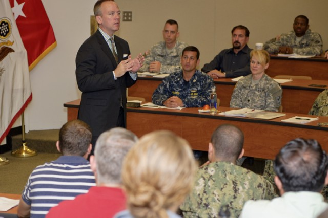 Under Secretary of the Army Brad R. Carson delivered the keynote speech and took questions from students of the Intel Law Course at the Judge Advocate General's Legal Center and School at the University of Virginia, at Charlottesville, Va., Aug. 15, 2014.
