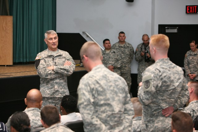Sgt. Maj. of the Army Raymond Chandler III speaks to Fort Huachuca, Ariz., Soldiers about battle buddy safety during a town hall meeting held at Cochise Theater, Aug. 20, 2014.