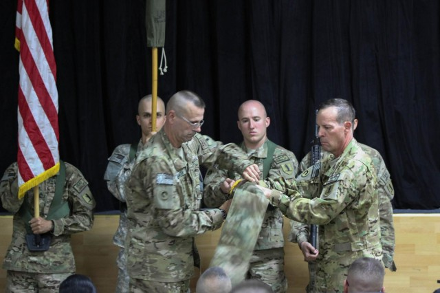 Col. David Dippold, 1107th Theater Aviation Sustainment Maintenance Group commander, and Command Sgt. Maj. Edward Lambeth, 1107th TASMG senior noncommissioned officer, case the group colors during a transfer of authority ceremony at Camp Arifjan, Kuwait, Aug. 11, 2014. The 1107th TASMG, an Army National Guard unit from Springfield, Mo., relinquished authority of their mission to the 1100th TASMG, an Army National Guard unit out of Edgewood, Md. (U.S. Army photo by Sgt. Tracy R. Myers, U.S. Army Central)