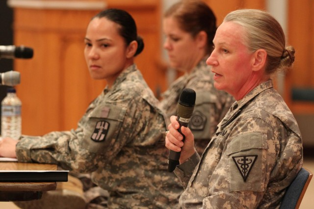 """A Panel of Service Members consisting of Col. Lisa Doumont, 3rd Medical Command Deployment Support, Detachment 7 commander, and two noncommissioned officers, speak of their experience with Sexual Harassment/Assault Response and Prevention to the audience after the dramatic reading of the provocative play """"Tape"""" by Outside the Wire, Aug. 5, 2014. They offered personal knowledge advise to the audience prior to an open discussion. (U.S. Army photo by Sgt. Tracy R. Myers, U.S. Army Central)"""